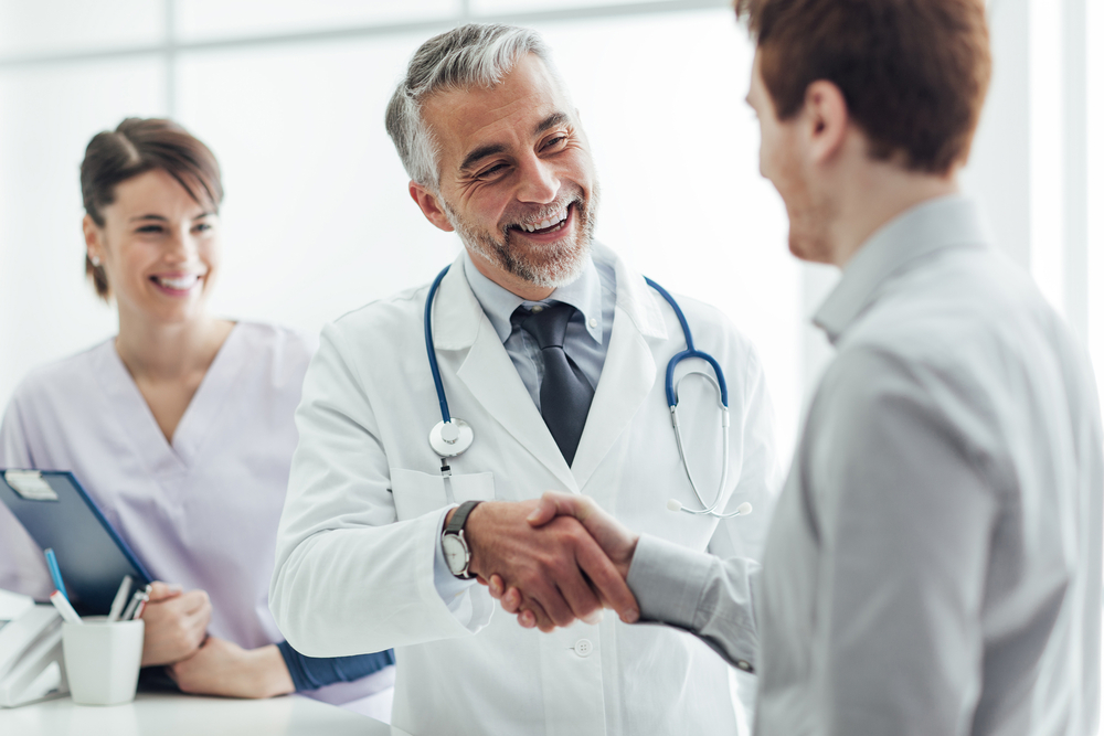 A doctor shaking his patient's hand